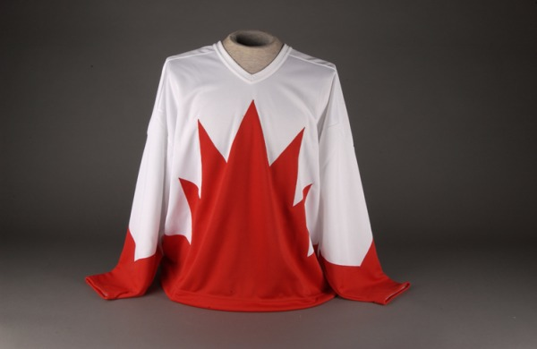 white hockey jersey with red maple leaf