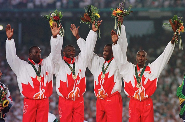 photograph of the 1996 men's relay team with medals