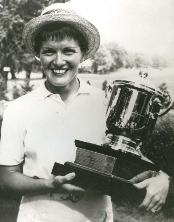 photograph of Marlene Steward Streit holding Duchess of Connaught trophy