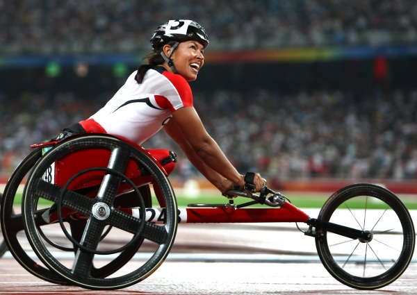 photograph of Chantal Petitclerc in race wheelchair