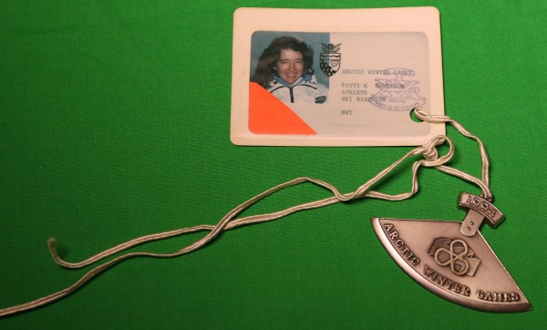 Image of accreditation and silver ulu medal won by Patti-Kay Hamilton at the 1994 Arctic Winter Games