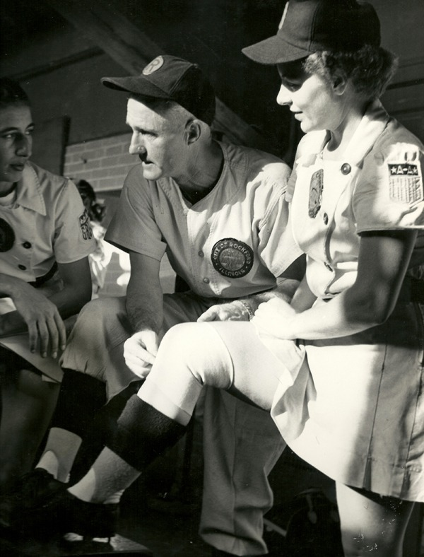 photograph of Helen Nicol Fox in dugout with coach
