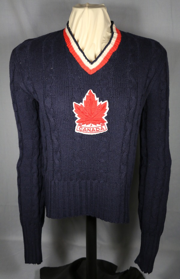 blue wool sweater with red maple leaf crest