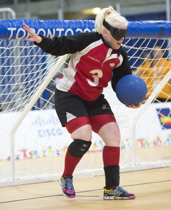 photograph of Whitney Bogart in front of goal in Goalball game
