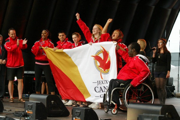 Athletes holding Canada Games flag