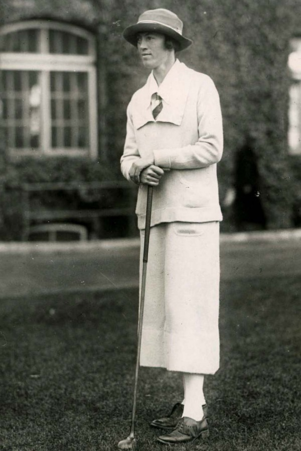 photograph of Ada Mackenzie standing with golf club