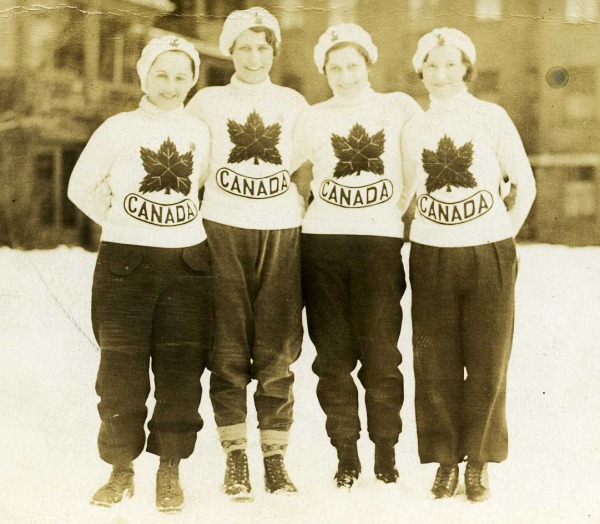 photograph of Lela Brooks and three members of the speed skating team