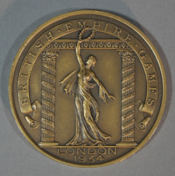circular medal with image of Victory holding wreath