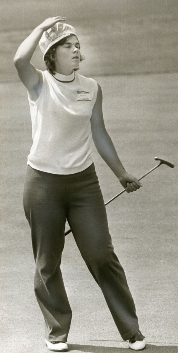 photograph of Jocelyne Bourassa holding golf club on course