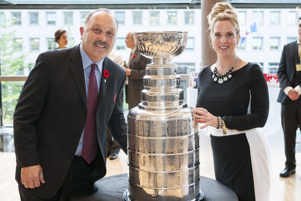 Photo of Bryan Trottier and friend beside Stanley Cup at his 2016 induction to Canada's Sports Hall of Fame