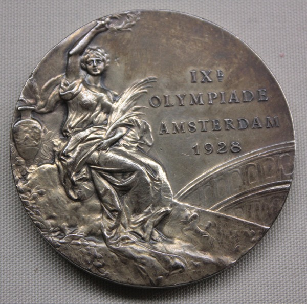 gold medal with image of Victory and Amsterdam 1928