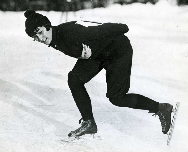 photograph of Lela Brooks skating with hand behind her back