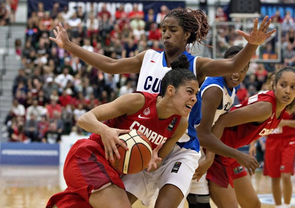 Photograph of Kia Nurse driving past opposition player in basketball game