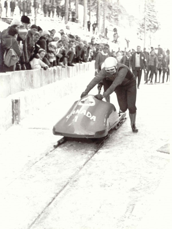 photograph of Vic Emery and Peter Kirby pushing bobsled