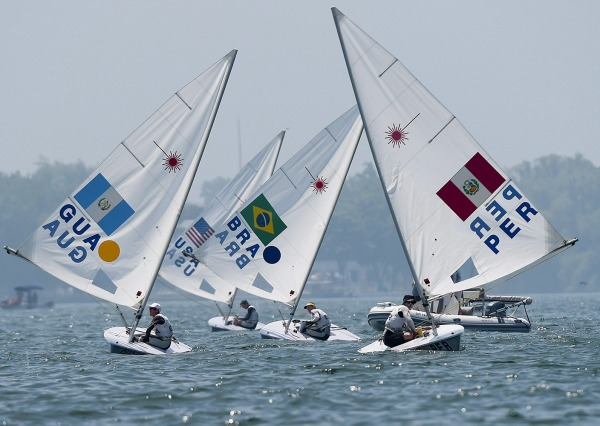 four laser sailboats in competition