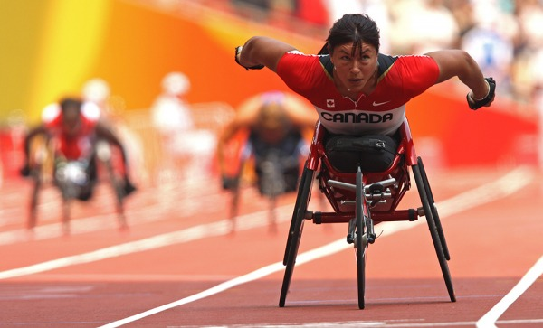 photograph of Chantal Petitclerc competing in wheelchair race