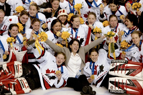 photograph of 2002 Women's Olympic Team with medals