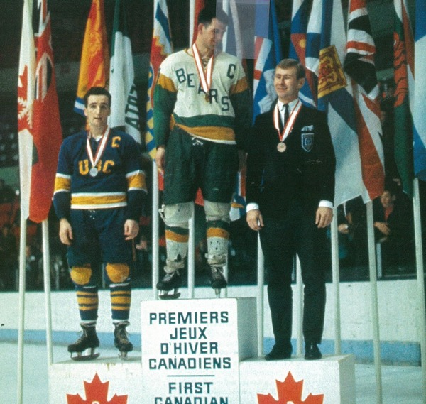Photograph of medallists from ice hockey competition on podium