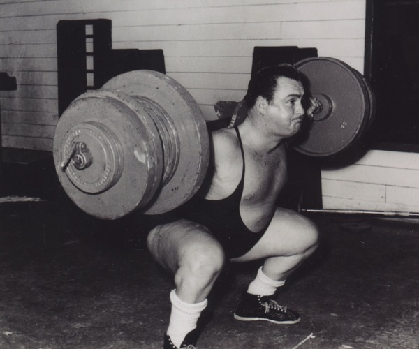 Photograph of Doug Hepburn lifting barbell on shoulders