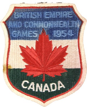 Crest with red maple leaf and reads British Empire and Commonwealth Games 1954 Canada