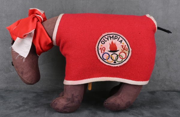 toy horse mascot wearing blanket with Olympic crest