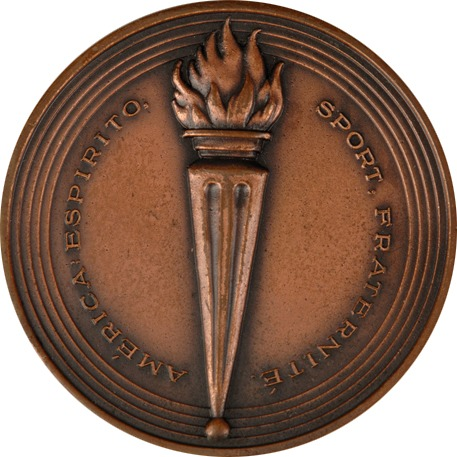 circular bronze medal with torch at centre