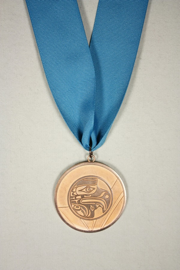 Bronze medal with image of thunderbird