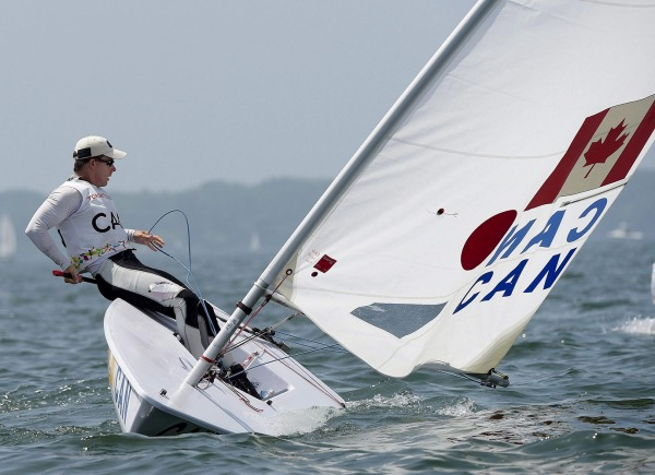 photograph of athlete sailing in laser sailboat