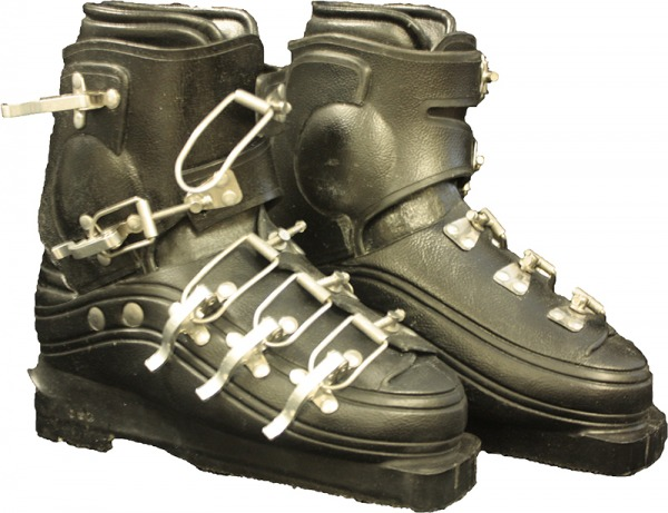black plastic ski boots with metal clasps across instep and ankle